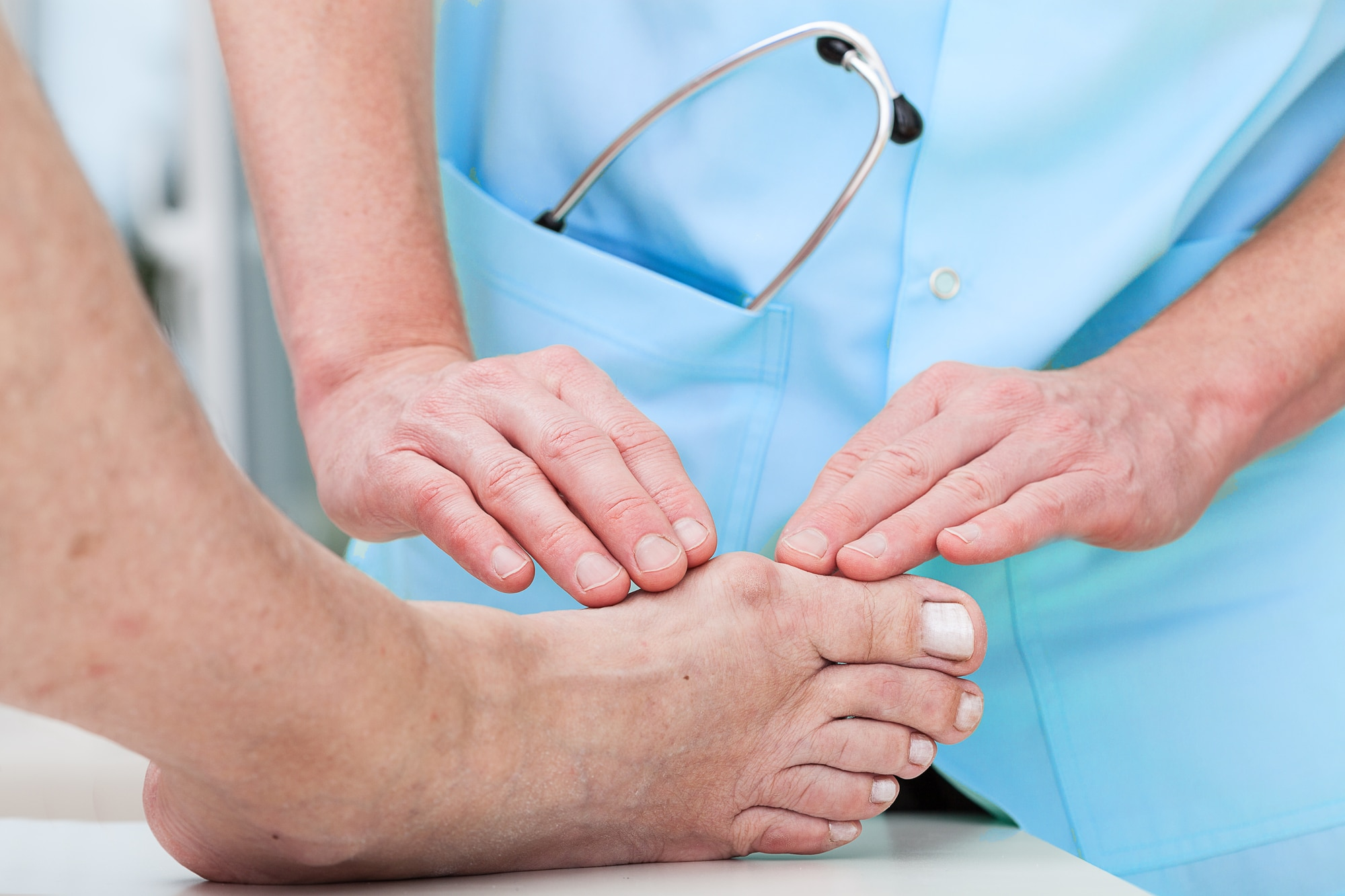 Diabetic foot doctor at work helping a patient
